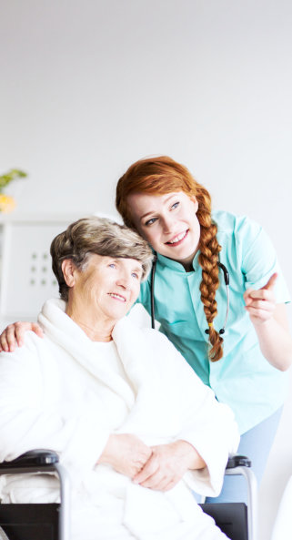 old woman and caregiver looking on outside