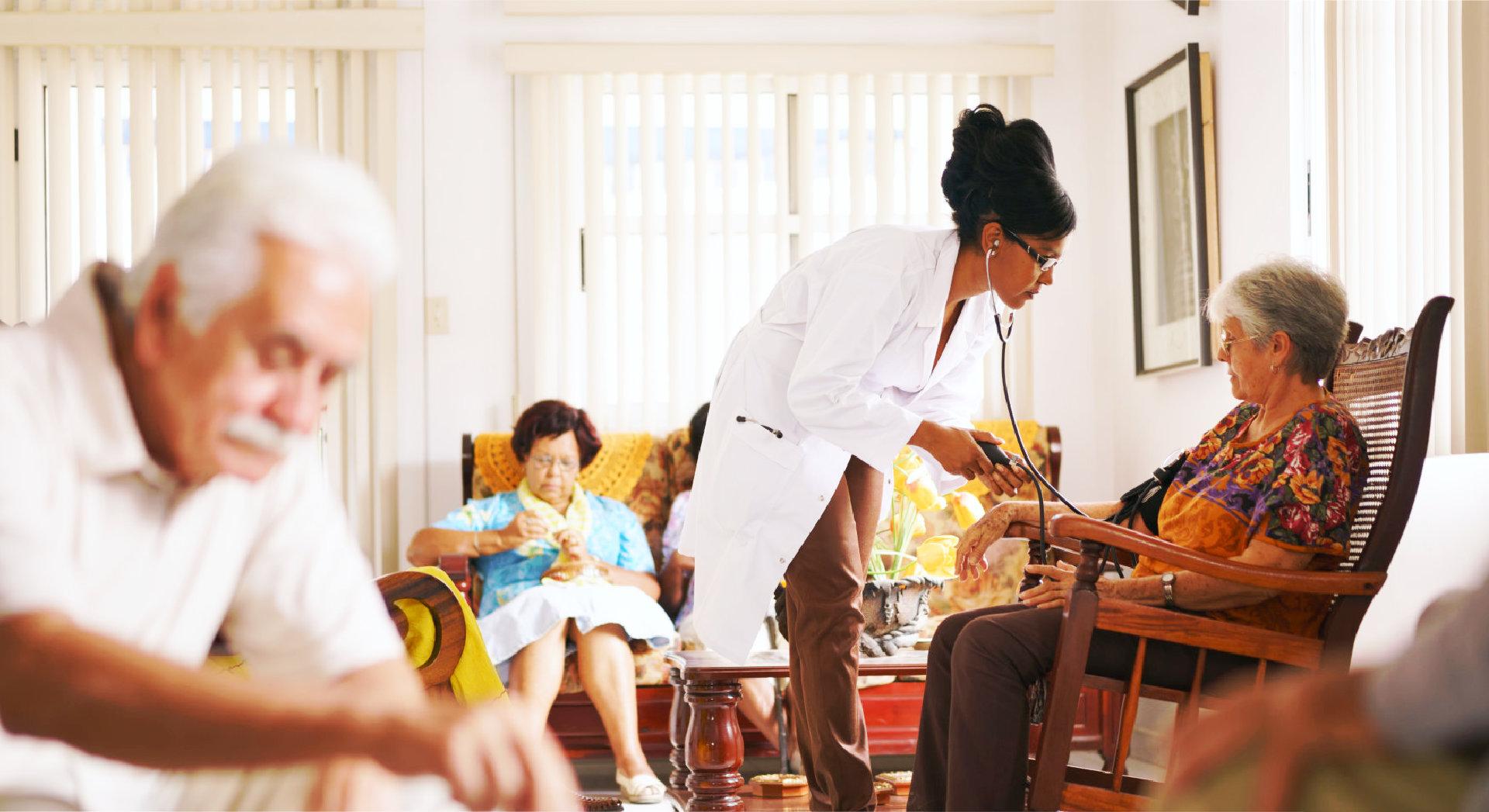doctor checking blood pressure of seniors