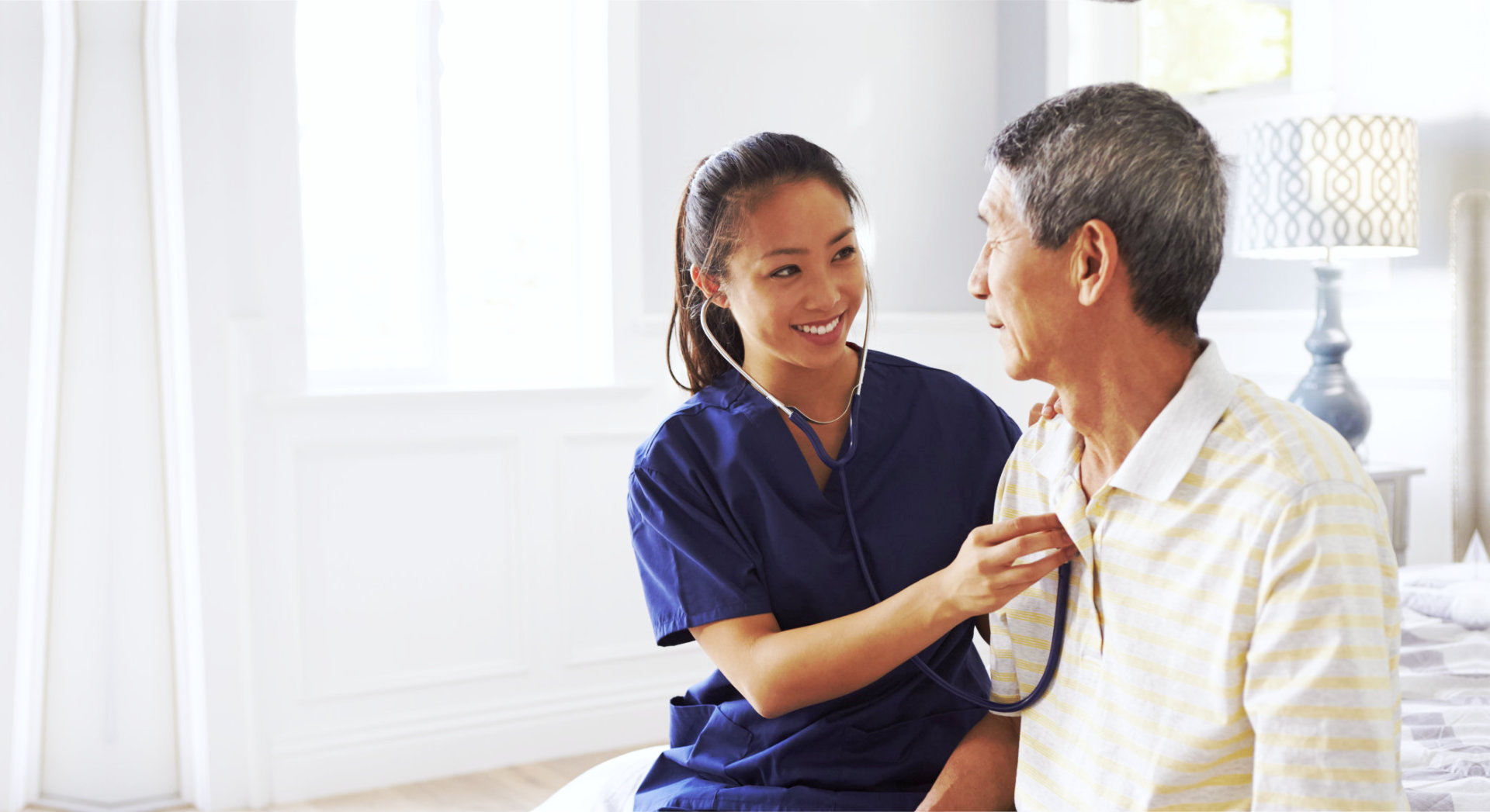 caregiver checking heartbeat of old man